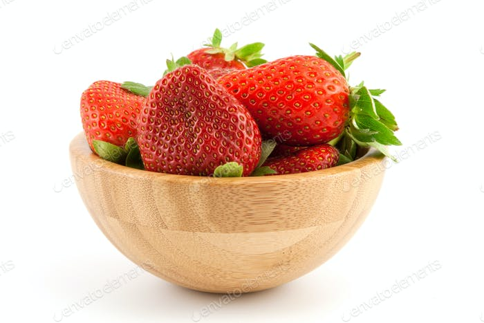 Ripe red strawberries in a bowl