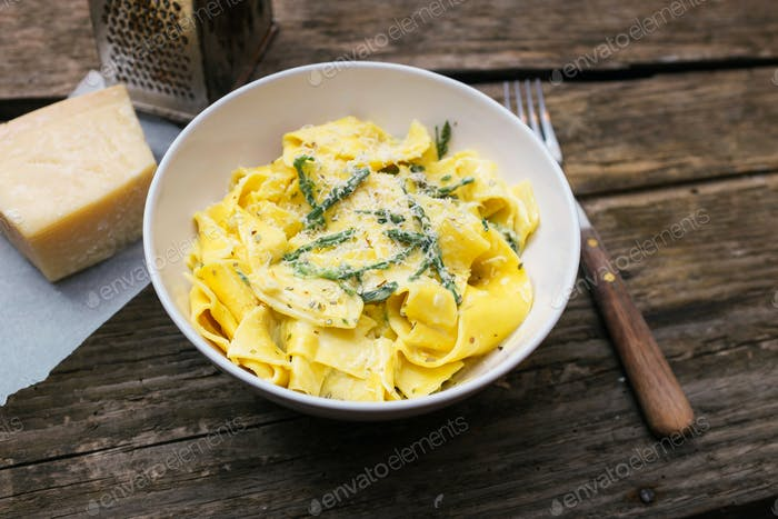 Homemade pasta with wild asparagus and grated Parmesan