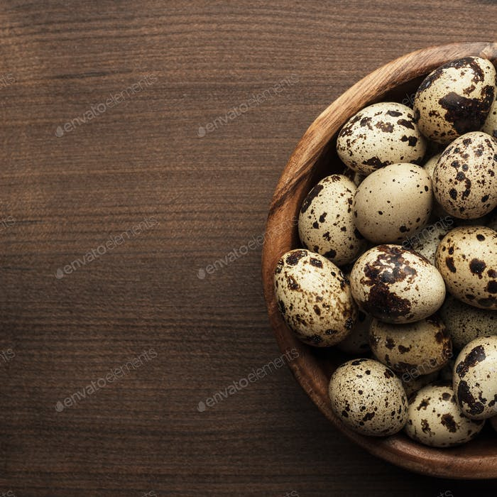 Quail Eggs On The Brown Wooden Table