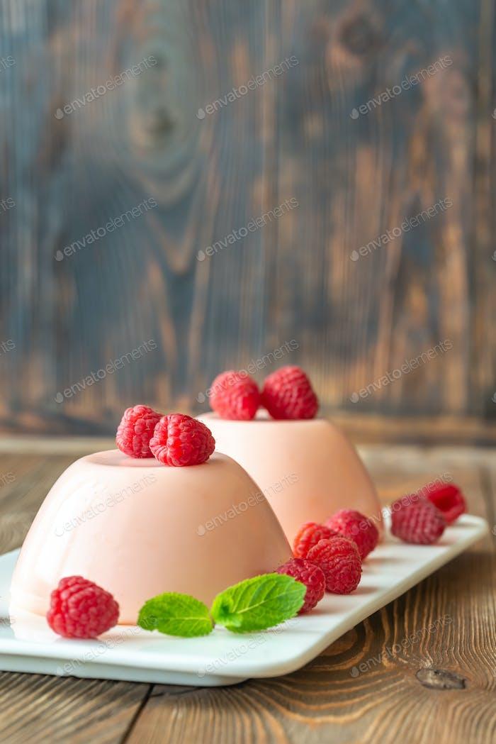 Dessert puddings with raspberries