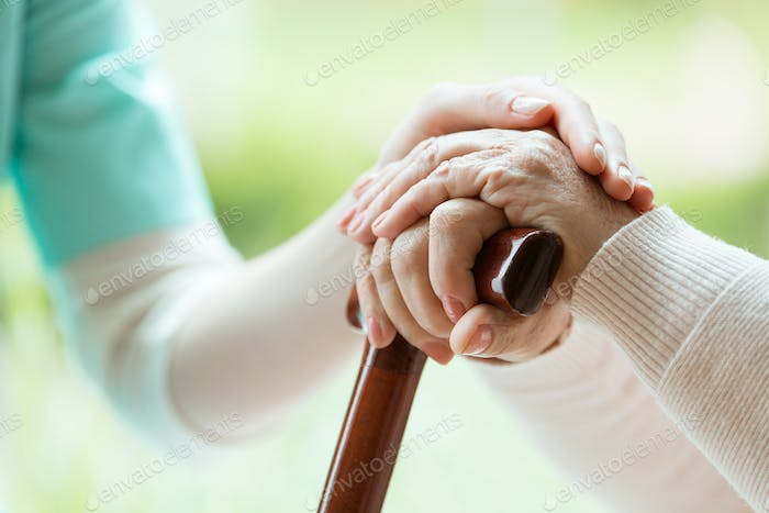 Nurse comforting elder lady