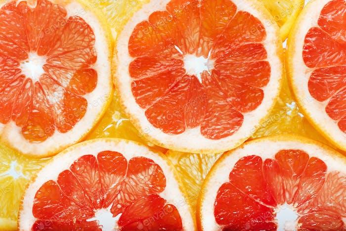 Hintergrund von Zitrusfrüchten Orangen und Grapefruitscheiben. Studi