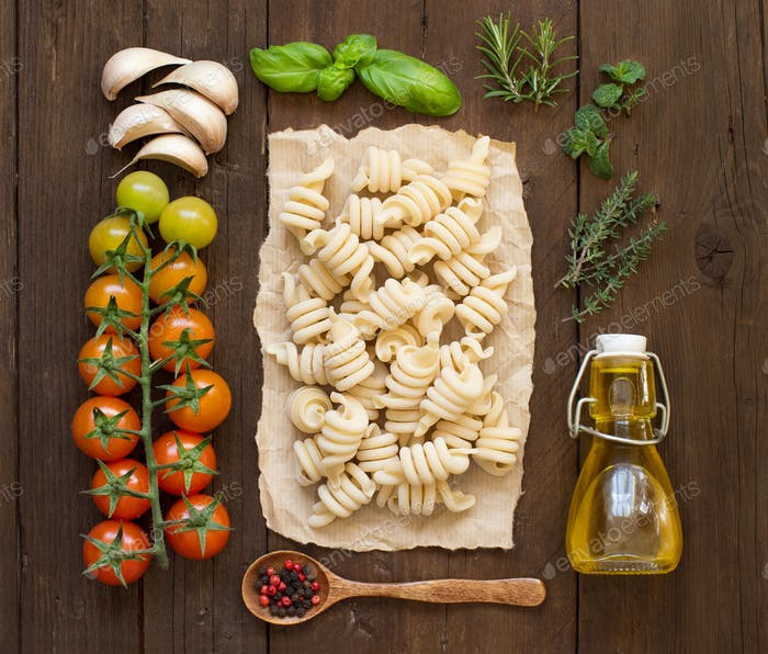 Italian pasta, vegetables,  herbs and olive oil