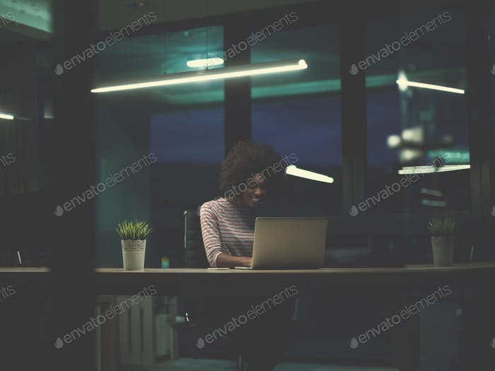 black businesswoman using a laptop in startup office