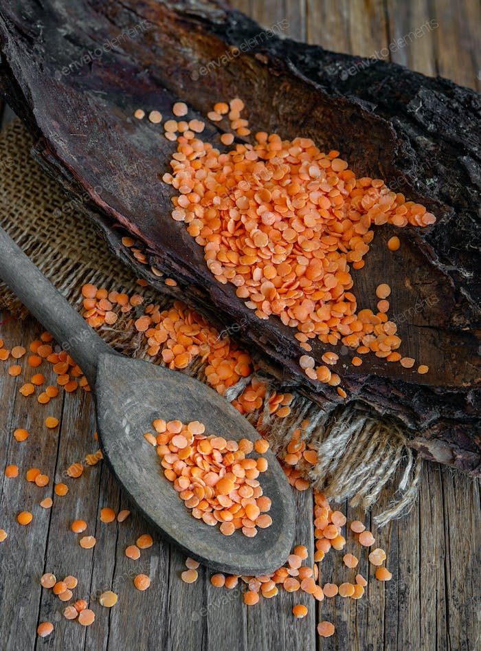 Wooden spoon with red lentils