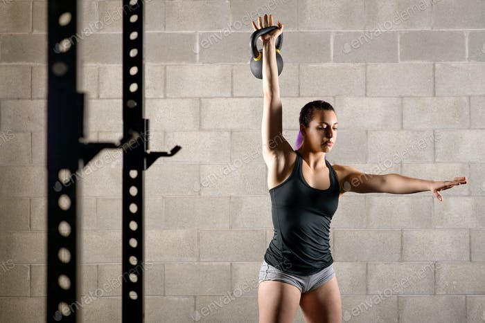 Muscular strong young woman working out