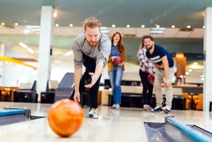 Friends bowling at club