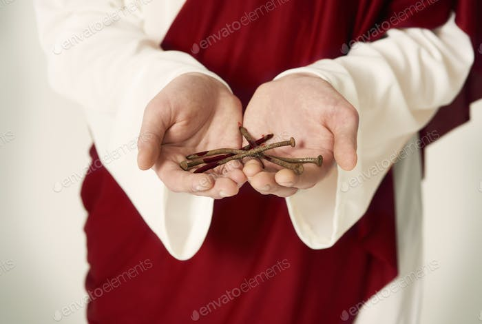 Jesus hands holding rusty nails