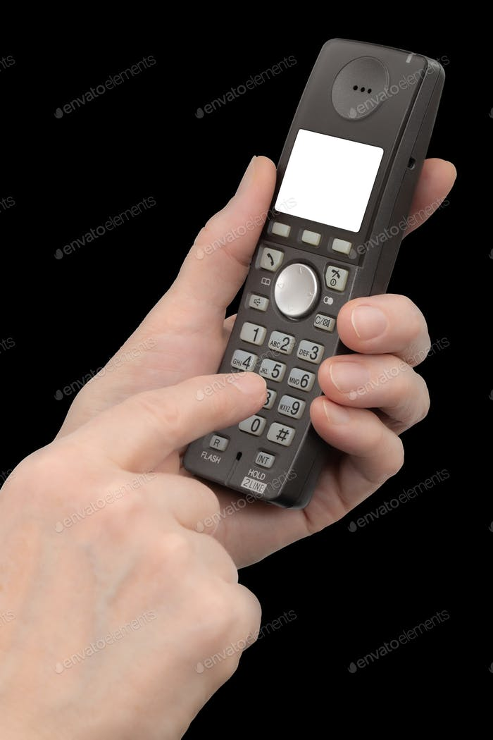 Female hand holds a phone with a white blank screen, isolated on black background