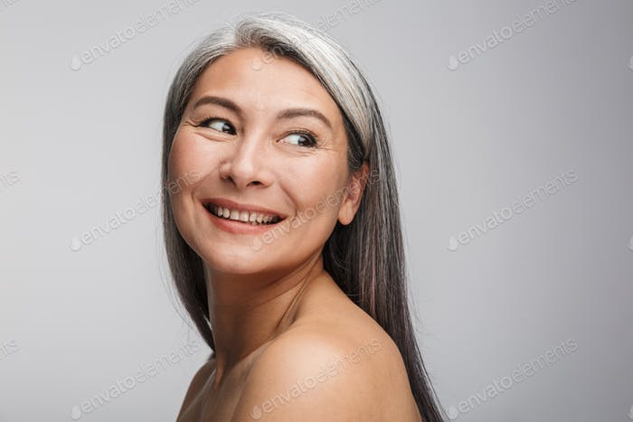 Beauty portrait of an attractive mature topless woman