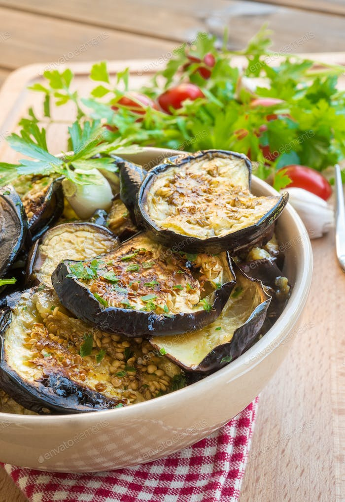 Grilled eggplant on rustic table