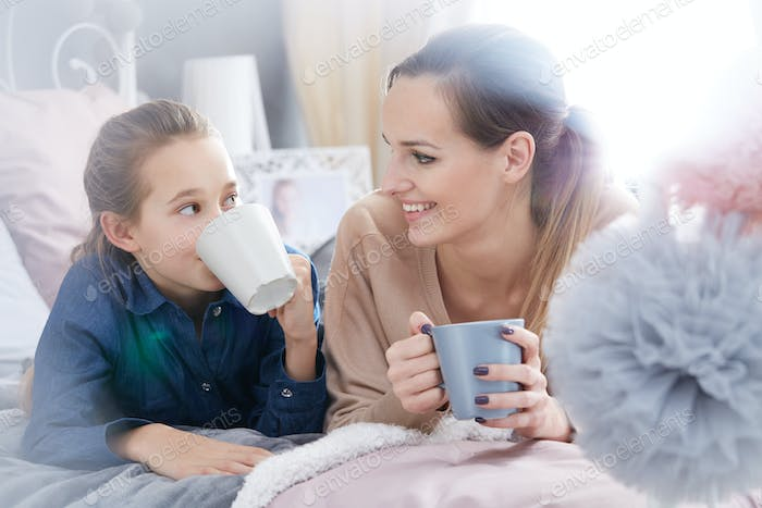 Mother and daughter with cups