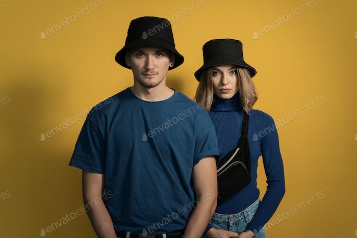 Portrait young couple on yellow background