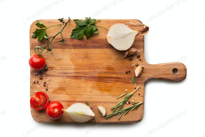 Frame from cherry tomatoes, onion on wooden board