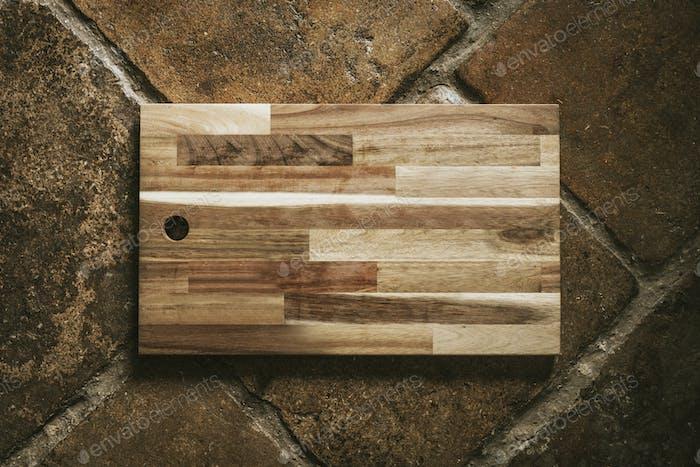 Blank wooden cutting board flatlay