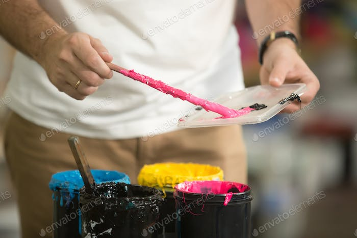 Close up of male hands combining CMYK