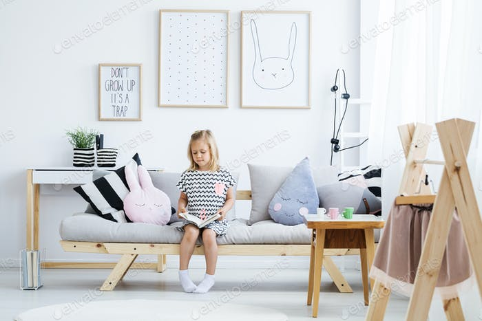 Girl reading on sofa