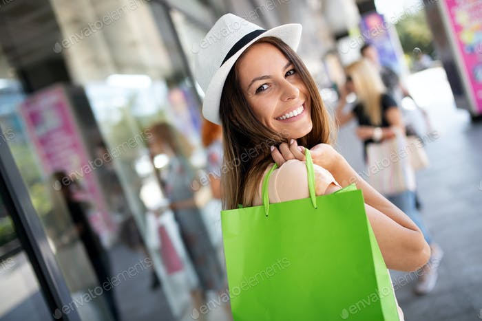 Shopping, fun and travel concept. Woman with shopping bags