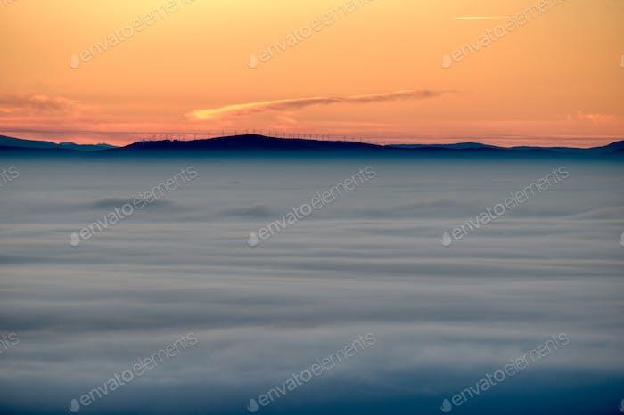 Sunrise over a sea of fog