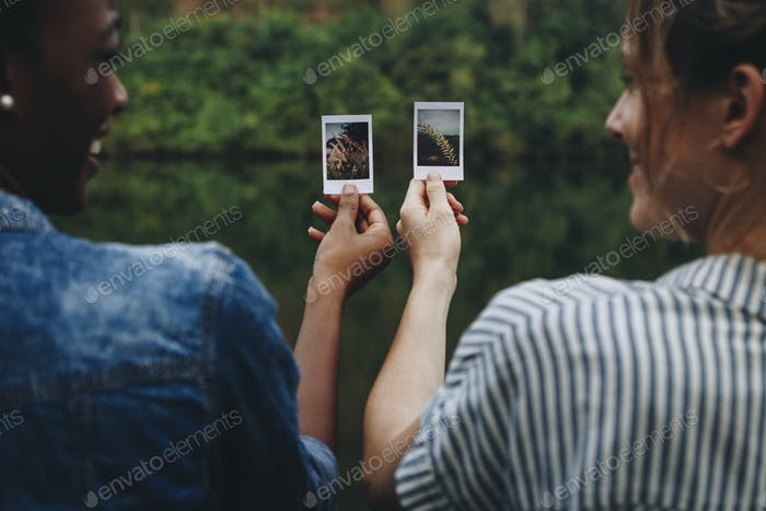 Two young female adult friends outdoors friendship bonding and photography concept