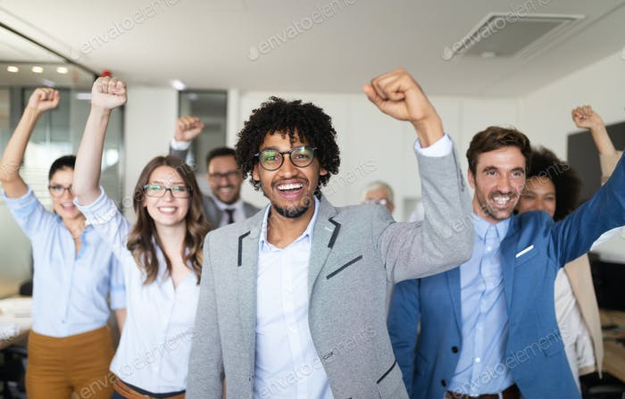Group of successful business people in office