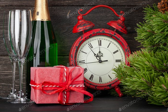 Christmas greeting card with fir tree and alarm clock