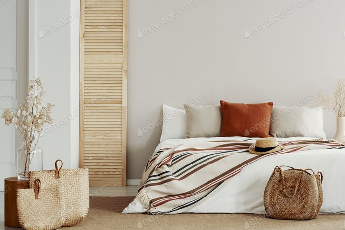 Natural bright bedroom with autumn accents, copy space on white