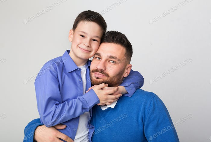 Happy family portrait. Cute boy embracing his father