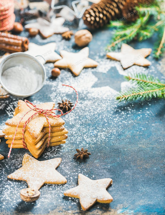 Christmas star shaped gingerbread cookies with cinnamon, anise and nuts