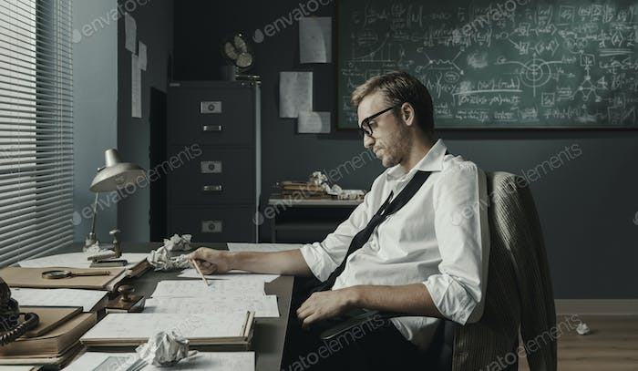 Young creative mathematician working in the office