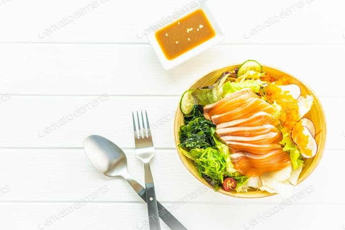 Raw fresh salmon fish meat sashimi with seaweed and other vegeta