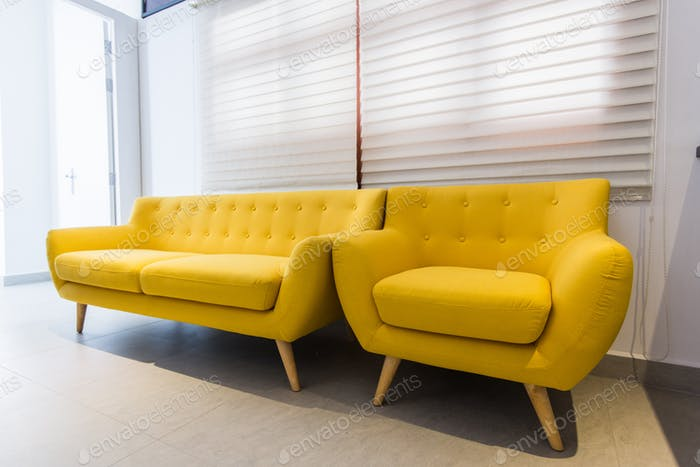 old sofa vintage yellow at home or hotel interior