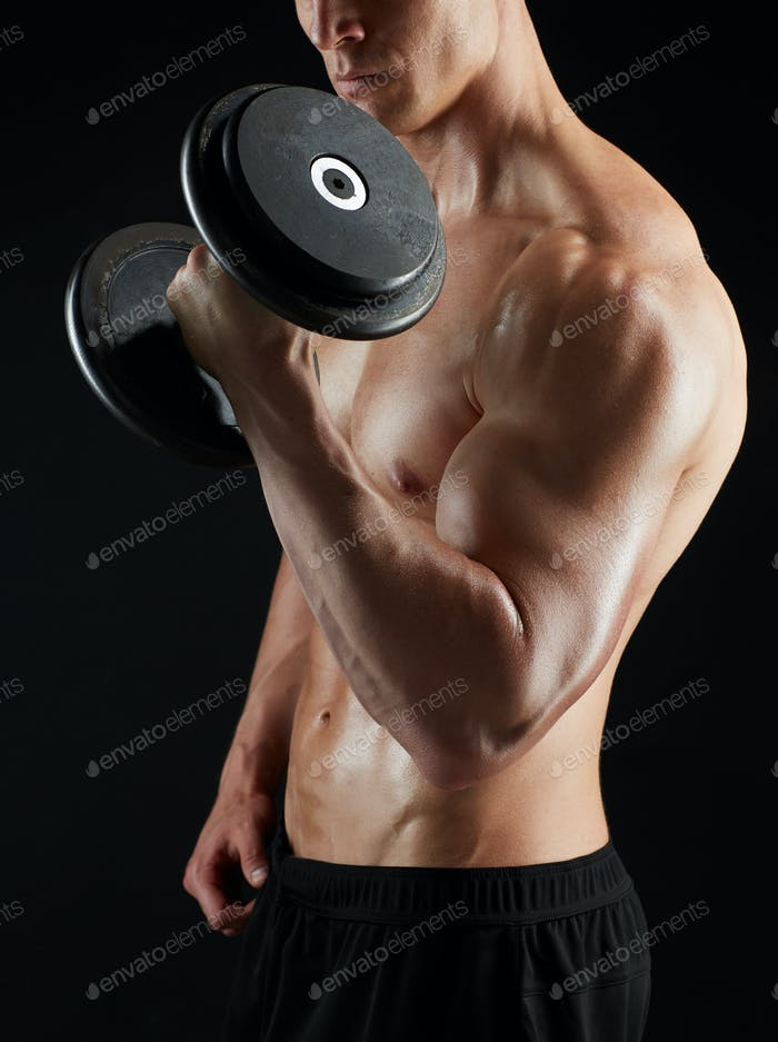 close up of man with dumbbells exercising