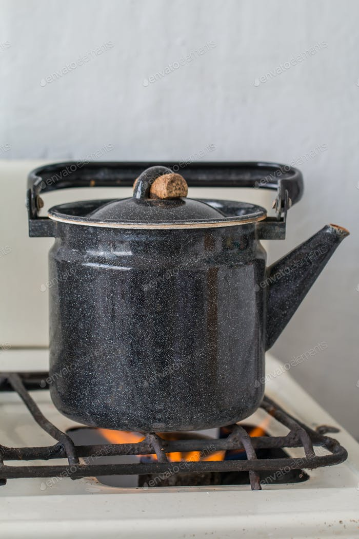 Old kettle on a gas stove
