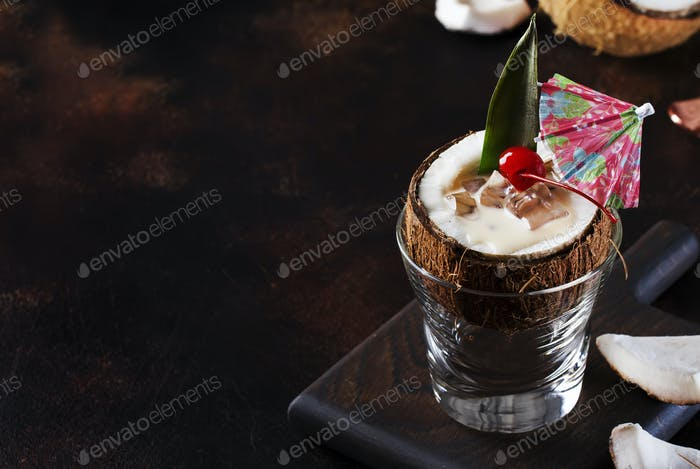 Pina Colada Cocktail in chopped coconut with tropical fruits