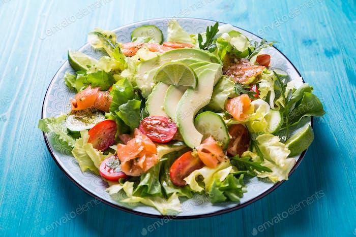 Healthy salad with smoked samlmon and avocado