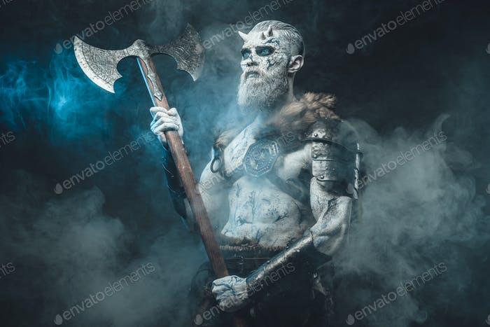 Frosty fog and northern warrior with huge axe and naked torso
