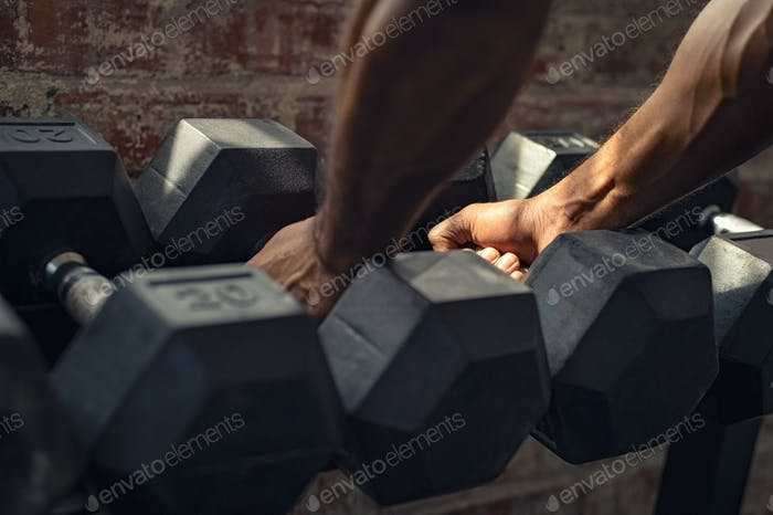 Man taking dumbbell weights