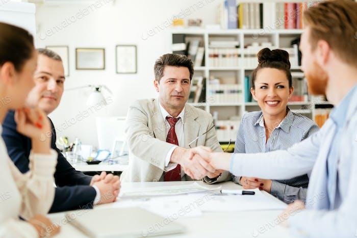 Businesspeople shakind hands