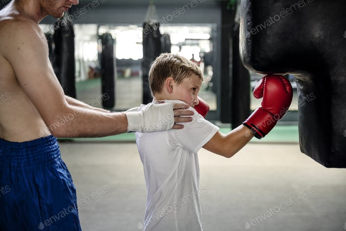 Boy Boxing Training Punching Bag Exercise Concept