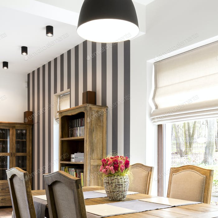 Stylish dining room with wooden furniture