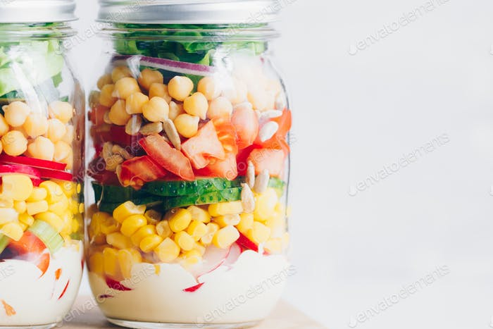 Closeup of jars with layering vegan salad