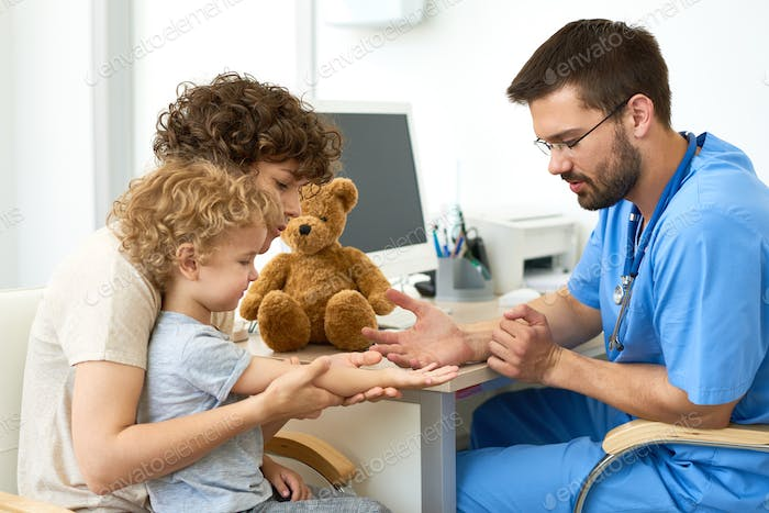Pediatrician Working with Child in Office