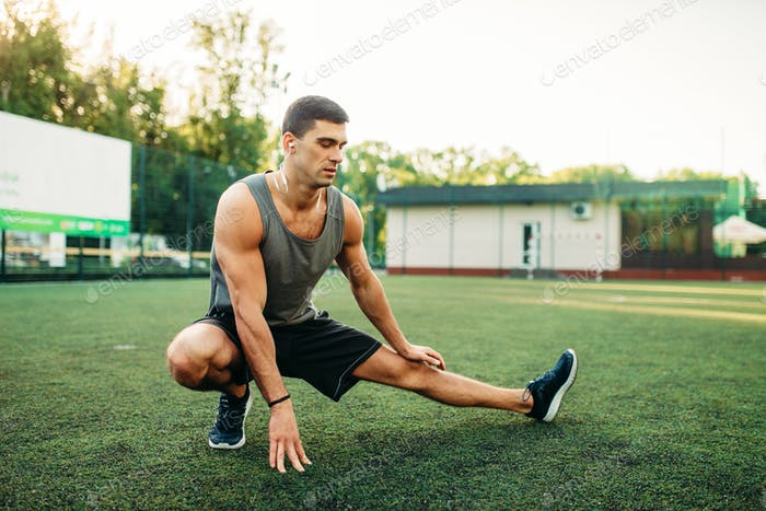 Man doing stretching exercise on outdoor workout