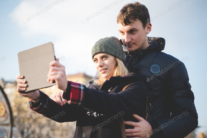 young couple lovers authentic using tablet