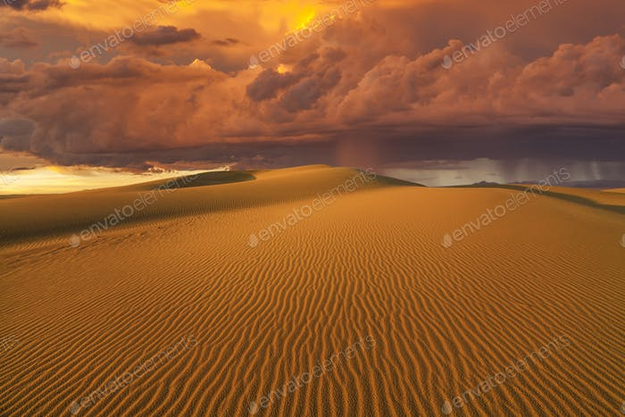 Amazing fiery rain clouds over the Gobi desert. Mongolia.