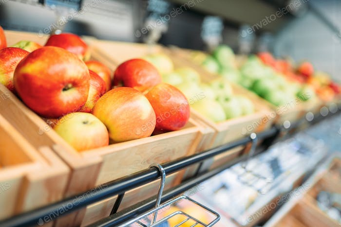 Box with fruits on stand in food store, nobody