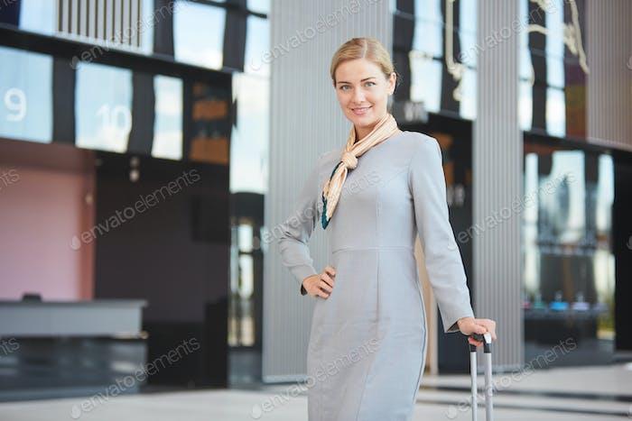 Elegant Stewardess in Airport