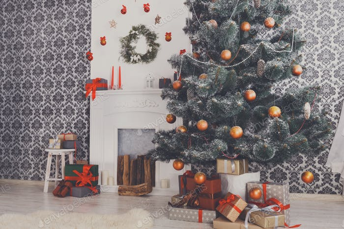 Beautiful christmas decorated tree in modern interior, holiday concept