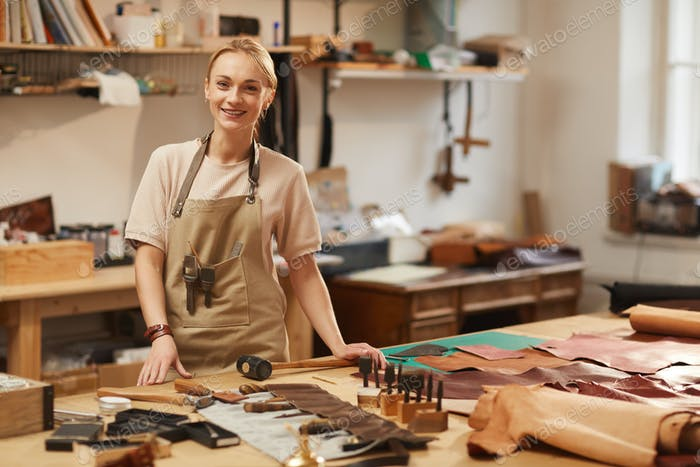 Happy Female Artisan At Work